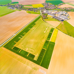 Aerial view to green fields with farm house and road. Agricultural landscape in Czech Republic, Central Europe.