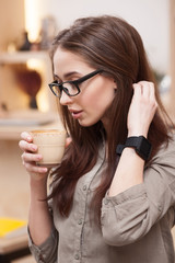 Beautiful girl is enjoying hot beverage