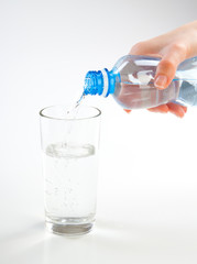 woman hands pouring fresh blue water from bottle