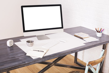 Wooden desktop with white screen