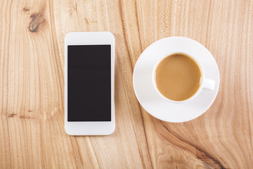 Coffee and phone on table