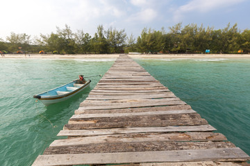 Jetty and small boat at Koh Rong island, Cambodia, South East Asia