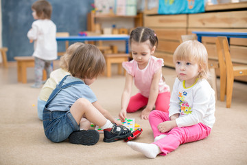 children playing games in kindergarten playroom