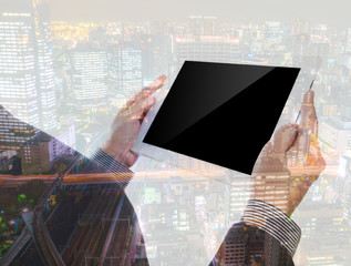 Double exposure of businessman using touch screen device with ci