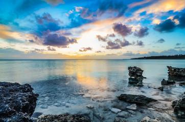 Sunset over a rocky shoreline on Eleuthera (Bahamas)