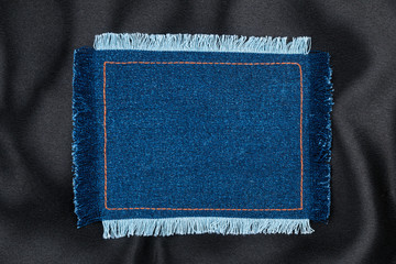 Frame made of denim fabric with yellow stitch on black silk  with space for your text