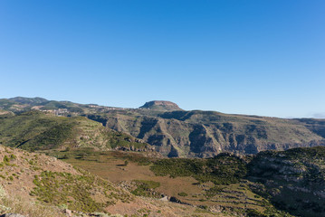 View to the tableland La Fortaleza and the mountain village Chipude situated In the highlands of La Gomera on the Canary archipelago. La Fortaleza is famous and one of the big landmarks on the Island