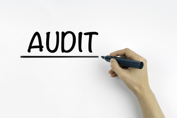 Hand with marker writing: AUDIT