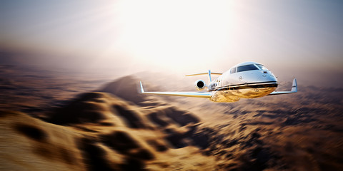Picture of silver modern and luxury generic design private jet flying blue sky at sunrise.Uninhabited desert mountains background.Business travel picture.Horizontal,motion blurred effect.3d rendering