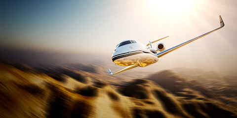 Photo of white Business generic design Private jet flying in blue sky at sunset.Uninhabited desert mountains background.Luxury travel picture. Horizontal,motion blurred effect. 3d rendering