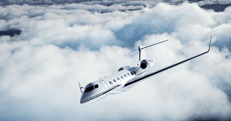 Photo of White Luxury generic design private jet flying over the earth. Huge white clouds at background. Business Travel Concept. Horizontal. 3d rendering