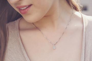 Detal of woman wearing a luxury pendant