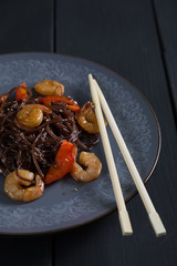Rice noodles with vegetables and shrimps