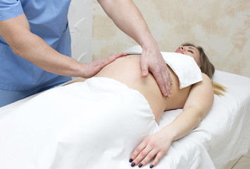 processes salon doing massage to a pregnant woman
