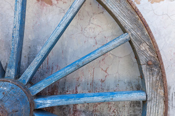 Part of old ironed, blue wagon or carriage wheel
