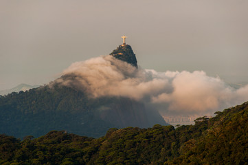 Wall Mural - Corcovado Mountain with Christ the Redeemer Statue is being surrounded by clouds