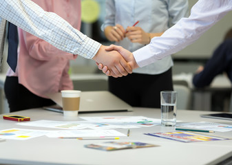 Businessmen shaking Hands after Discussion