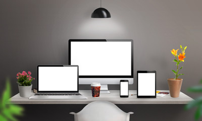 Wall Mural - Responsive devices on desk with isolated screen for mockup. Computer display, laptop, tablet and smart phone.