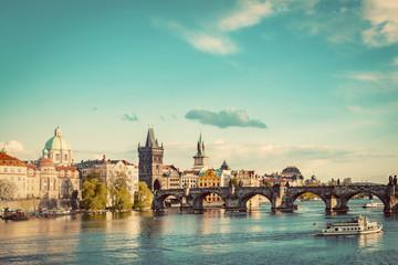 Prague, Czech Republic skyline with historic Charles Bridge and Vltava river. Vintage