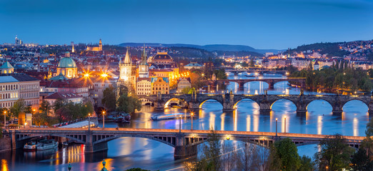 Prague, Czech Republic bridges panorama. Charles Bridge and Vltava river at night