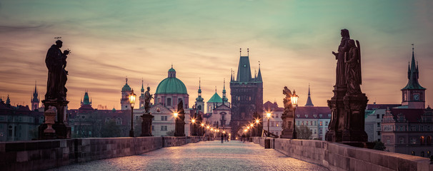 Acrylic Prints Prague Charles Bridge at sunrise, Prague, Czech Republic. Dramatic statues and medieval towers.