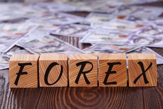 Forex. On the wooden cubes written forex.