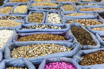 Row of healthy grain food and different kind mix of seed set closeup background