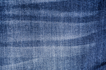 Dark blue jeans material texture background close up