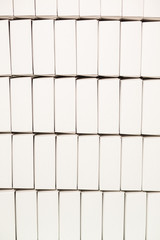 Rows of blank white boxes. Lots of plain boxes. Environmentally friendly material. Simple design of packaging.