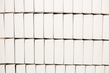 Lots of blank white boxes. Rows of rectangular boxes. Postal boxes in warehouse. New and clean.