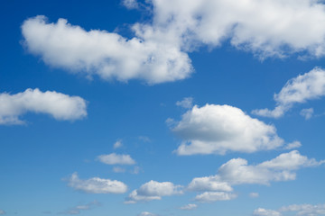 Blue sky and white clouds over horizon.