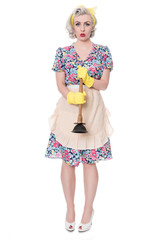 Sad fifties housewife with sink plunger, humorous concept, isola