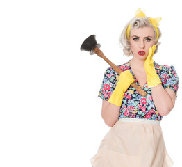 Worried fifties housewife with sink plunger, humorous concept, s