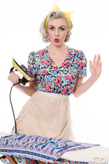 Fifties housewife pressing clothes with vintage iron, humorous c