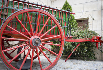 red and green old chariot used for decoration