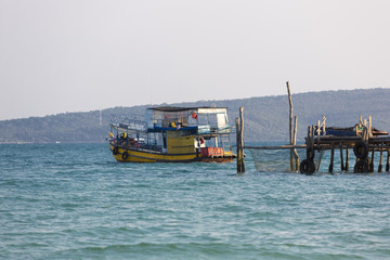 Sea view with khmer boat, beach of Koh Rong. Cambodia