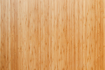 Closeup background photo of texture of wooden board made of bamboo