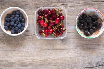 Berries on a wooden table in natural light