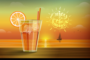 Glass with lemonad at sunset