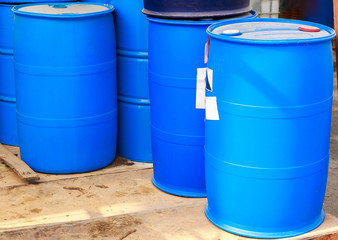 Some plastic blue barrels