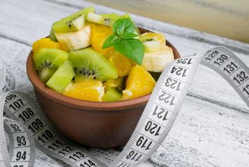 Fruit salad with kiwi, banana and orange for slimming and centim