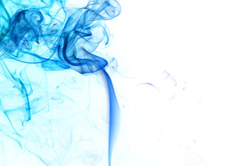 Abstract blue smoke from aromatic sticks.