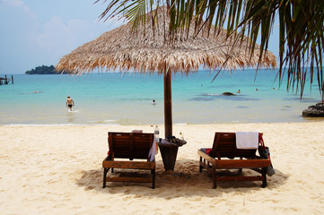Two chairs and umbrella on tropical island, Cambodia