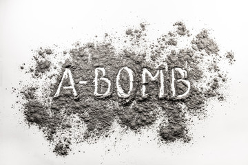 Atom bomb word written in explosion ash, dust cloud