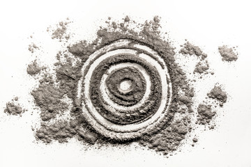 Bullseye, target, round, circle shape drawing in dust, ash, dirt