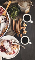 Cherry pie and a cup of coffee. Rustic style. Berry pie. Homemade cherry pie with flaky crust, cup of coffee, bowl with cherries