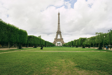 Park view of the Eiffel tower in Paris, France.