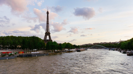 Seine river in Paris with Eiffel tower at sunset in France