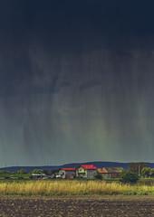 Heavy torrential rain pouring down a village in Transylvania region, Romania.
