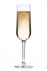 champagne flute full of champagne.